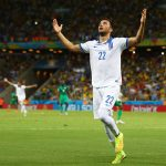 Andreas Samaris celebrates after scoring for Greece. (Getty Images)