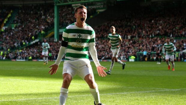 Celtic midfielder Callum McGregor ecstatic after his team scores a goal during one of their league encounters. (Getty Images)