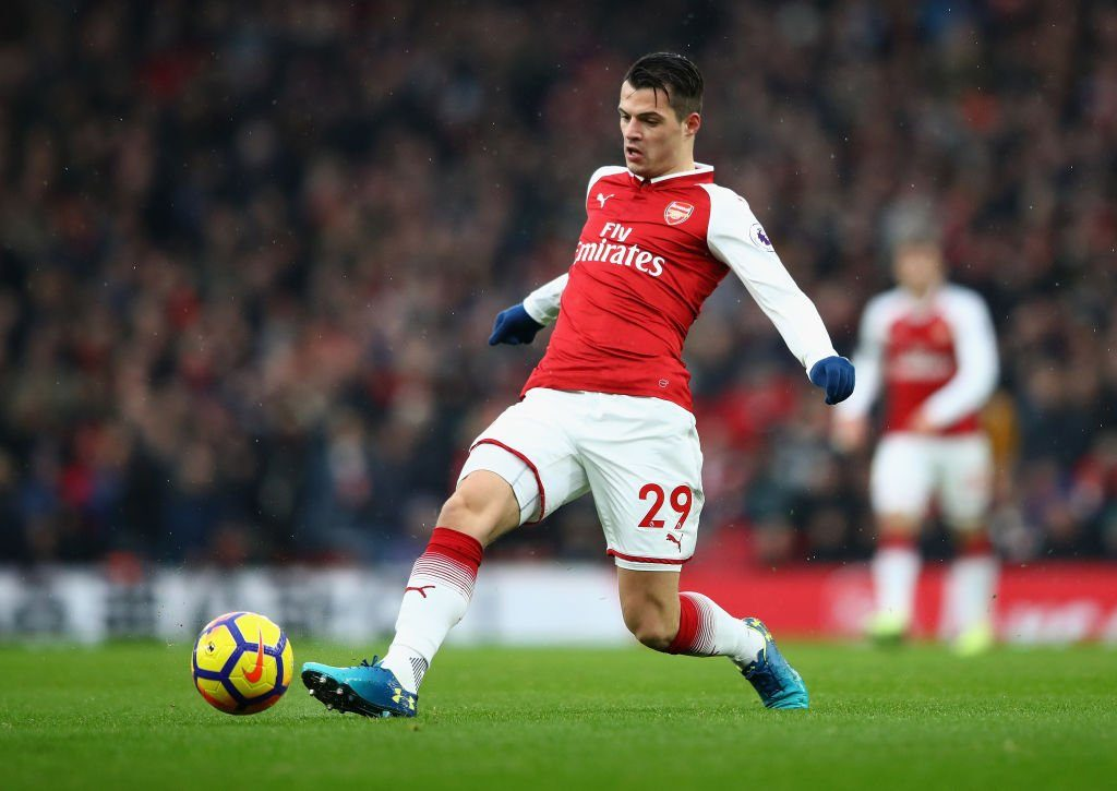 Arsenal midfielder Granit Xhaka passes the ball. (Getty Images)