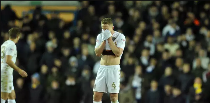 Leeds United midfielder Adam Forshaw reacts during a league encounter.