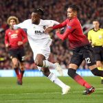 Manchester United's Chris Smalling battles with Valencia's Michy Batshuayi for the ball. (Getty Images)