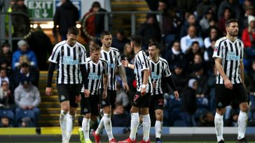 Newcastle United players celebrate after scoring. (Getty Images)