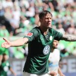 Wolfsburg striker Wout Weghorst celebrates after scoring. (Getty Images)