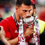Benfica midfielder Andreas Samaris kisses a trophy. (Getty Images)
