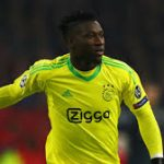 Ajax goalkeeper Andre Onana attempts to roll the ball. (Getty Images)