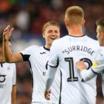 Swansea City players celebrate after scoring. (Getty Images)