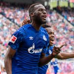 Salif Sane of FC Schalke 04 celebrates with teammate Rabbi Matondo Baba of VfL Wolfsburg after scoring his team's first goal during the Bundesliga match between RB Leipzig and FC Schalke 04 at Red Bull Arena. (Getty Images)