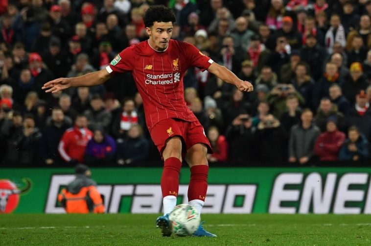 Liverpool's English midfielder Curtis Jones scores the winning penalty in a penalty shoot-out during the English League Cup fourth round football match between Liverpool and Arsenal at Anfield in Liverpool, north west England on October 30, 2019. (Getty Images)