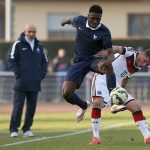 Maximilian Mittelstädt of germany challenges Enock Kwateng of france during the friendly match between U18 France and U18 Germany at Omnisports Stade Stadium on March 27, 2015 in Sarre-Union, France. (Getty Images)