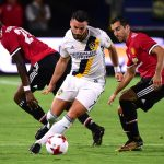 Romain Alessandrini of Los Angeles Galaxy turns from Timothy Fosu-Mensah and Henrikh Mkhitaryan of Manchester United during a 5-2 United victory at StubHub Center. (Getty Images)