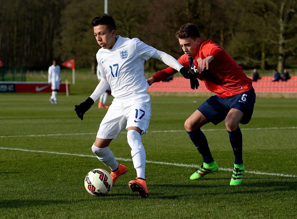 Ian Carlo Poveda of England U16 holds off a challenge from Erik Tobias Sandberg of Norway U16 during the U16s International Friendly match between England U16 and Norway U16 at St Georges Park on February 16, 2016 in Burton-upon-Trent, England. (Getty Images)