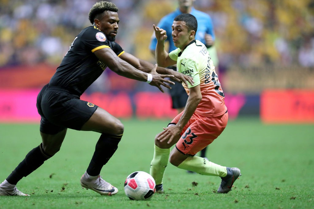 Ian Poveda of Manchester City and Adama Traore of Wolverhampton Wanderers compete for the ball during Manchester City v Wolverhampton Wanderers - Premier League Asia Trophy Final on July 20, 2019 in Shanghai, China. (Getty Images)