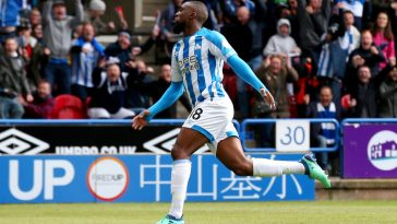 Isaac Mbenza of Huddersfield Town celebrates as he scores his team's first goal during the Premier League match between Huddersfield Town and Manchester United at John Smith's Stadium on May 05, 2019 in Huddersfield, United Kingdom. (Getty Images)