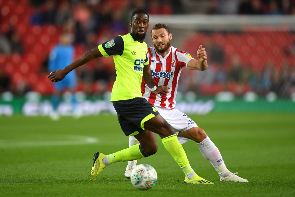 Isaac Mbenza of Huddersfield Town is challenged by Erik Pieters of Stoke City during the Carabao Cup Second Round match between Stoke City and Huddersfield Town at Bet365 Stadium on August 28, 2018 in Stoke on Trent, England. (Getty Images)