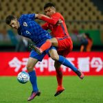 Mirko Maric (L) of Croatia challenges Paulo Diaz of Chile during the 2017 Gree China Cup International Football Championship match between Croatia and Chile at Guangxi Sports Center on January 11, 2017 in Nanning, China. (Getty Images)