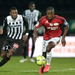 Amiens' French defender Prince-De Gouano (R) vies with Angers' Cameroonian forward Karl Toko Ekambi (L) during the French L1 football match between Angers (SCO) and Amiens (Amiens SC), on January 27, 2018, in Raymond-Kopa Stadium, in Angers. (Getty Images)