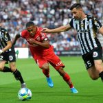 Dijon's French defender Mickael Alphonse (C) fights for the ball with Angers' French defender Rayan Ait-Nouri (L) and Angers' French midfielder Thomas Mangani during the French L1 Football match between SCO Angers and DFCO Dijon, on August 31, 2019, at the Raymond-Kopa Stadium in Angers, northwestern France. (Getty Images)