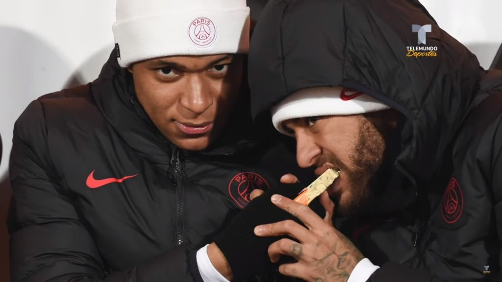 PSG attackers Neymar and Kylian Mbappe sharing a snack during one of their league encounters. (YouTube)