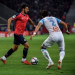 Marseille's Japanese defender Hiroki Sakai (R) vies with Lille's Turkish defender Mehmet Zeki Celik (L) during the French L1 football match between Lille and Marseille on September 30, 2018 at the Pierre Mauroy Stadium in Villeneuve d'Ascq, northern France. (Getty Images)