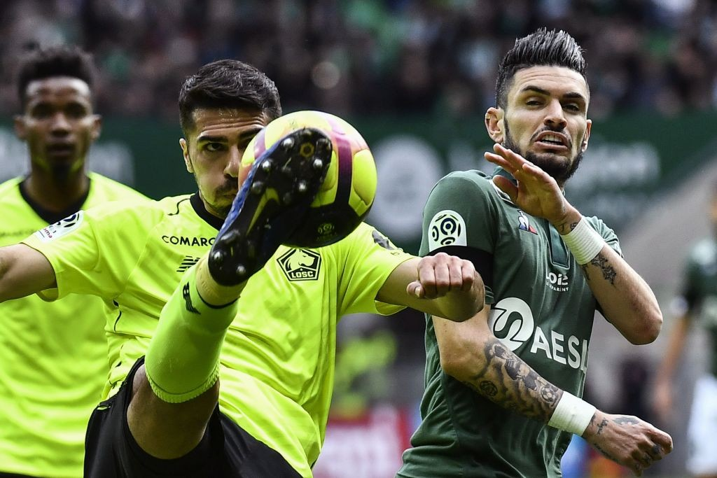 Lille's Turkish defender Mehmet Zeki Celik (L) vies with Saint-Etienne's French midfielder Remy Cabella (R) during the French L1 football match between AS Saint-Etienne (ASSE) and Lille (LOSC) on March 10, 2019, at the Geoffroy Guichard Stadium in Saint-Etienne, central France. (Getty Images)