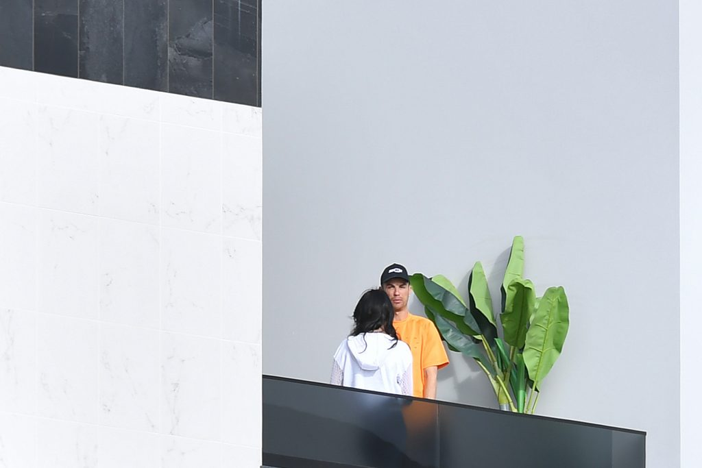 Cristiano Ronaldo and his partner Georgina Rodriguez stand on a balcony at their luxury villa in Madeira. (Getty Images)