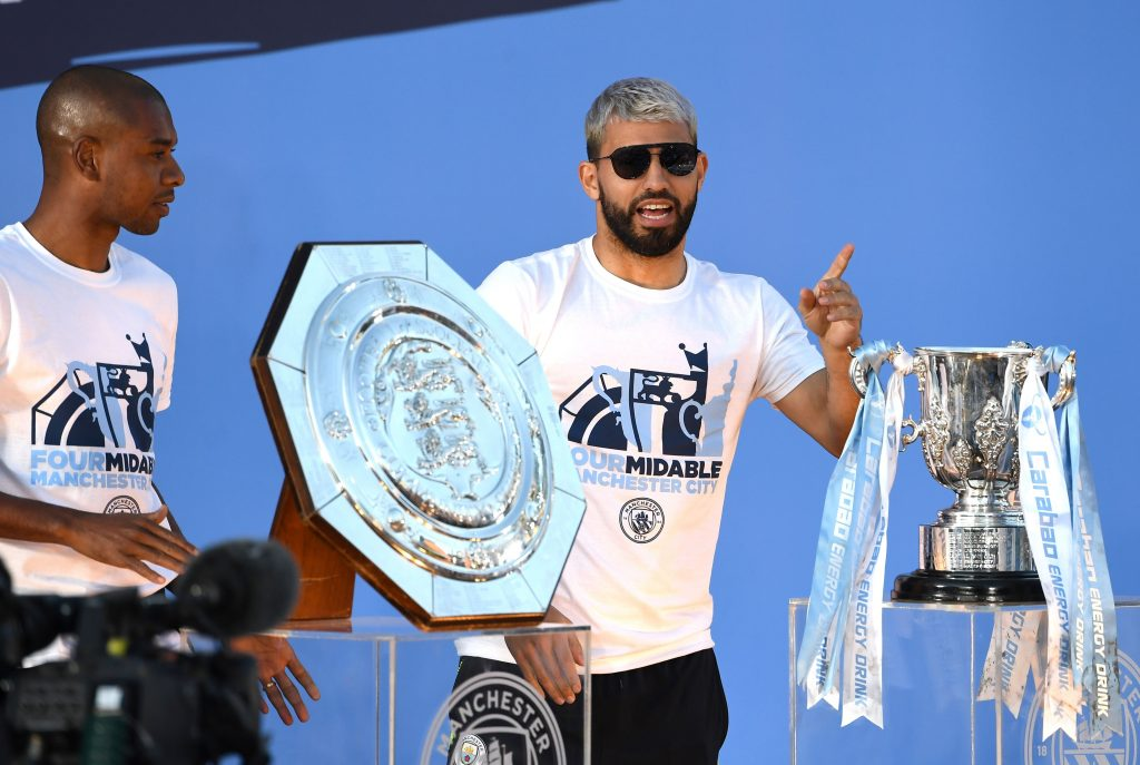 Sergio Aguero celebrates after winning a trophy with Manchester City